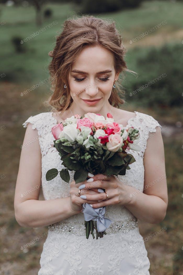 beautiful gorgeous bride with wedding bouquet portrait