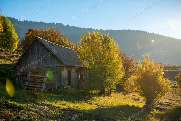 Alone house in autumn mountain