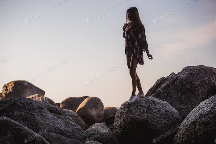 Outdoor summer stylish portrait of beautiful elegant woman with perfect fit body and long legs