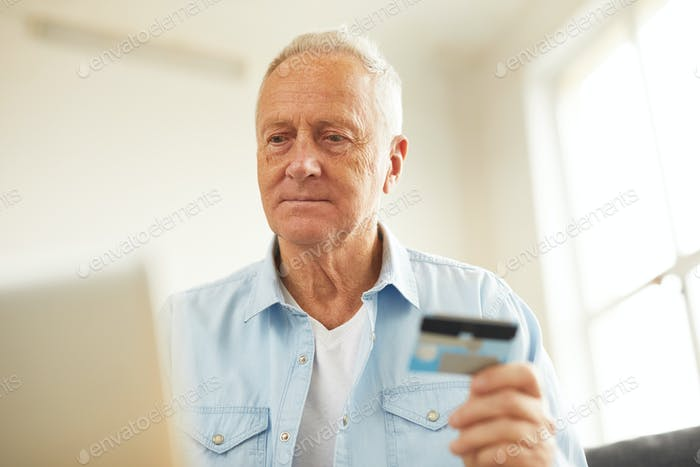 Senior Man Paying Taxes