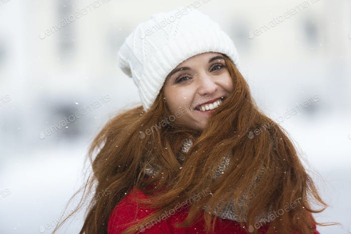 Portrait of beautiful smiling girl in winter clothes