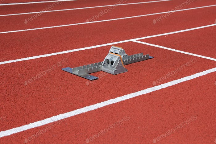 Athletics starting blocks on race track