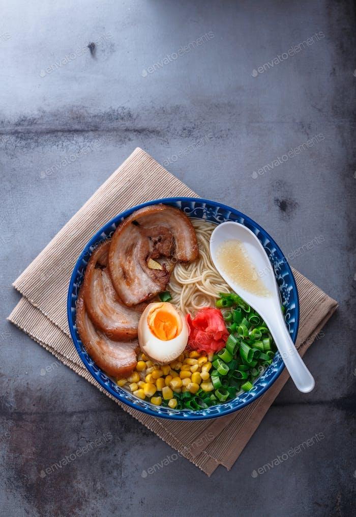 Japanese tonkotsu ramen, pork bone broth noodles, copy space