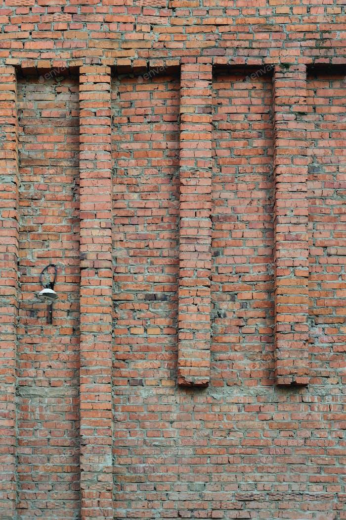 lantern on an old brick wall