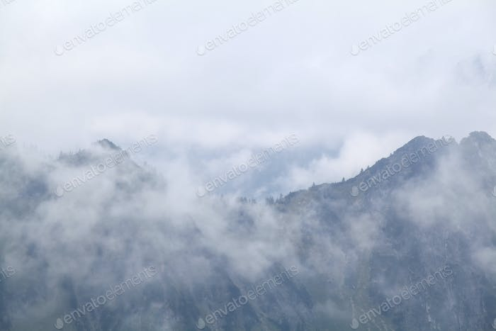 mountains in dense fog