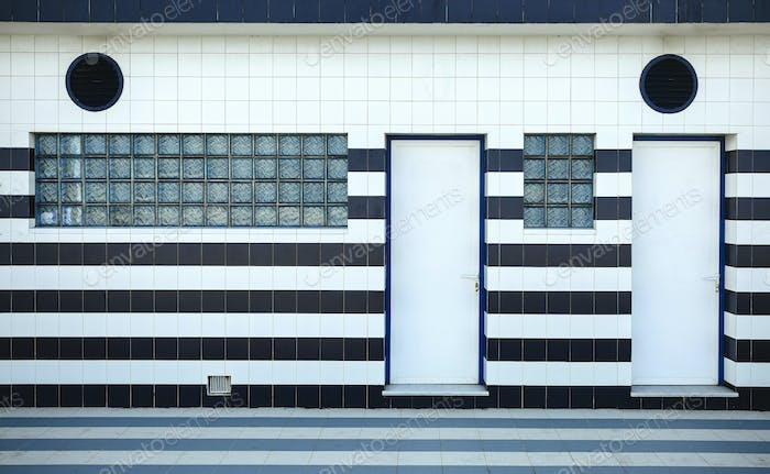 Blue and white tiled facade with glass blocks