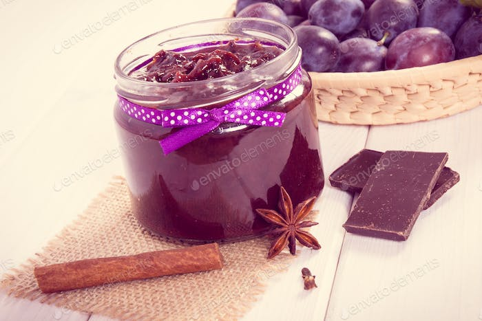 Vintage photo, Plum marmalade or jam in glass jar, fruits and chocolate, sweet dessert concept