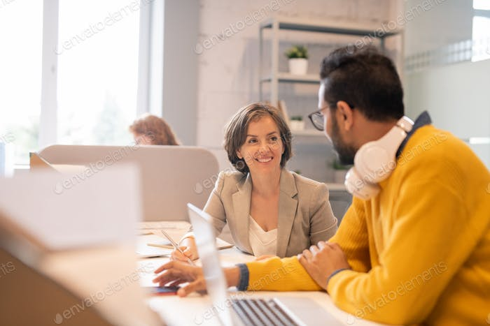 Positive purposeful young multi-ethnic colleagues