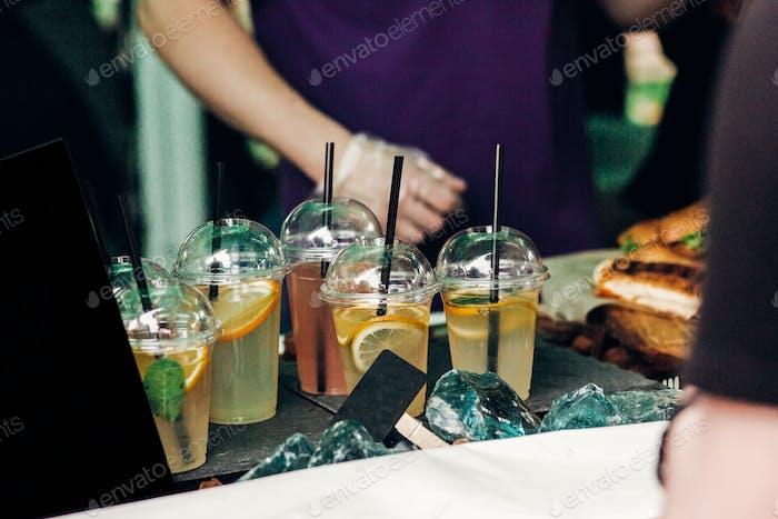 Lemonade with mint and lemons on table