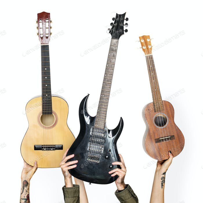 Variation hands holding guitars