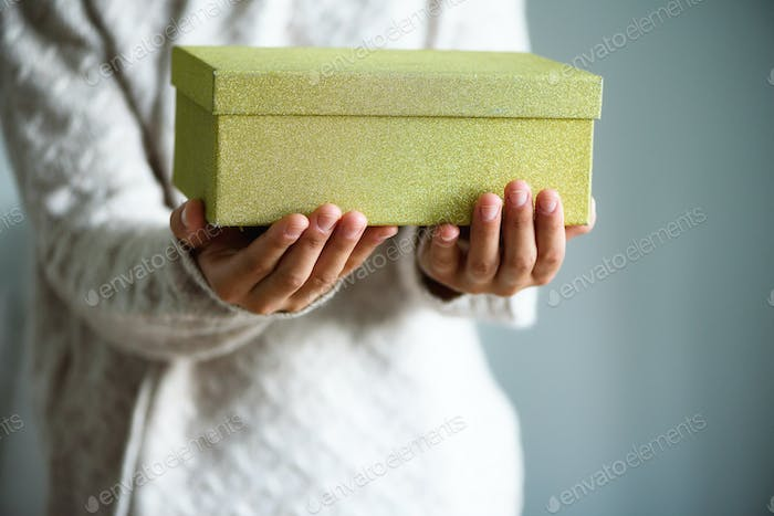 Female hands opening gift box, copy space. Christmas, hew year, birthday concept