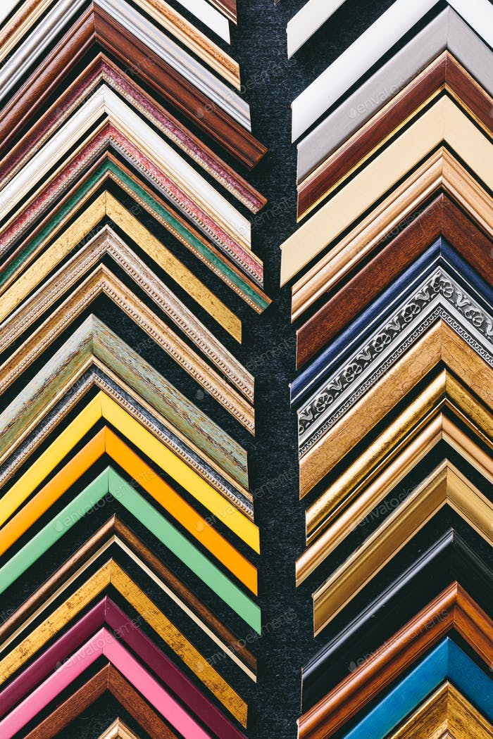Wooden picture frames on wall in a store, background