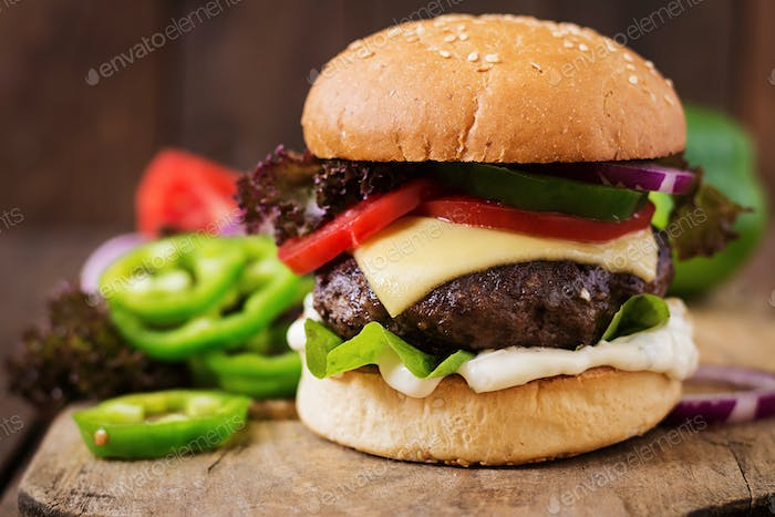 Big sandwich - hamburger burger with beef, cheese, tomato and tartar sauce