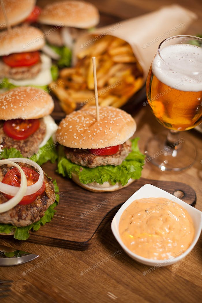 Spicy sesame souce with delicious beef burgers and beer