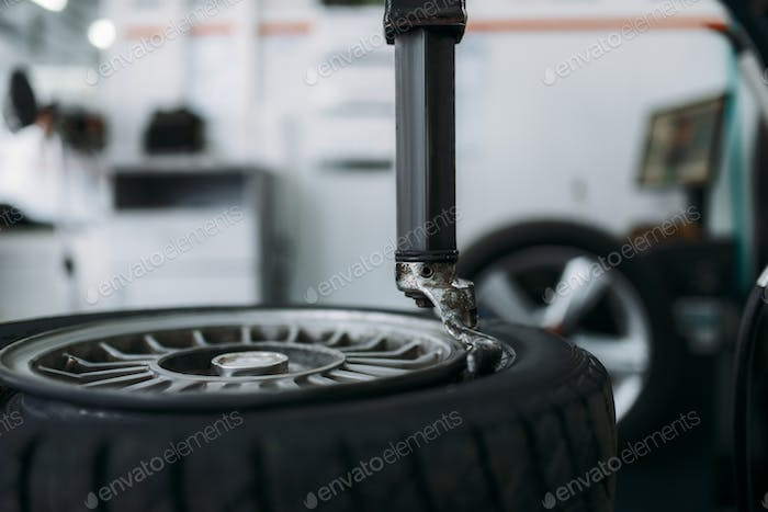 Car wheel standing on tire fitting machine