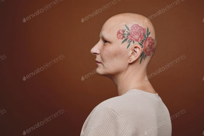 Side View of Bald Woman with Head Tattoo