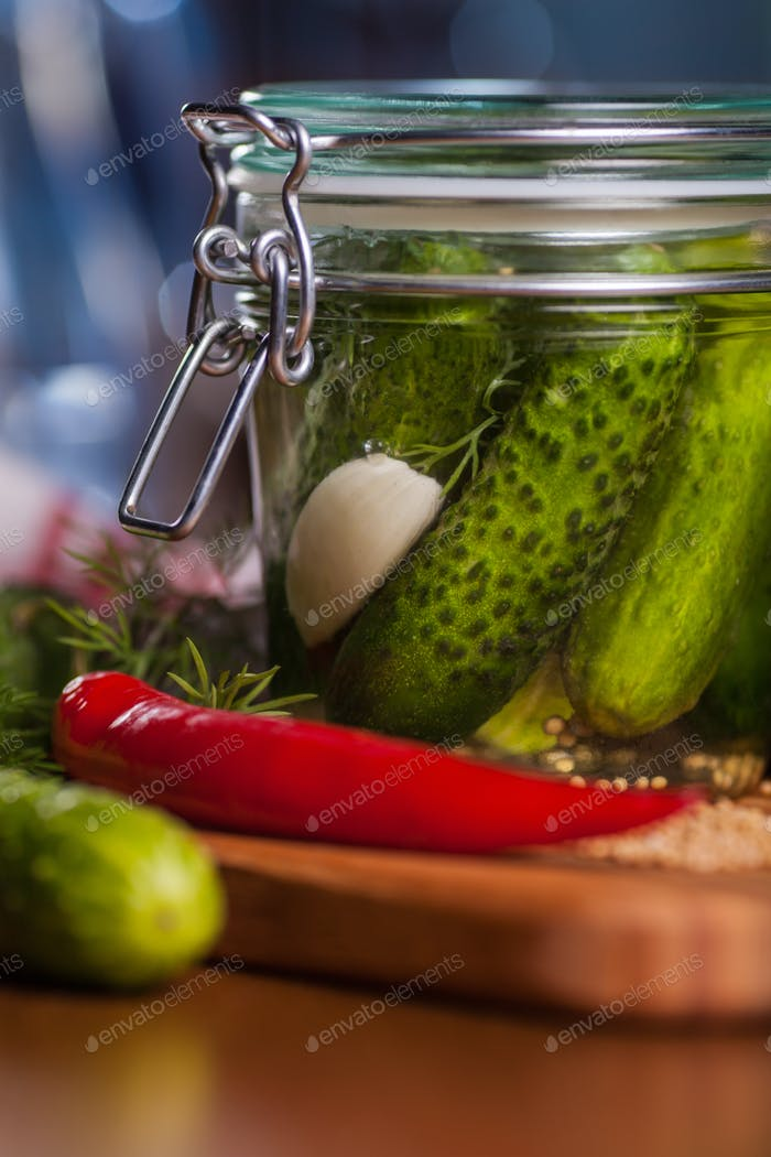 Close up of jar with pickled cucumbers
