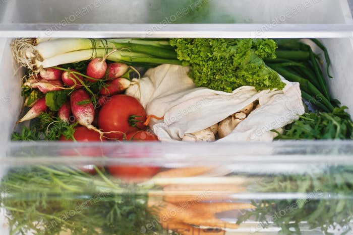 Zero waste grocery in fridge. Fresh vegetables in opened drawer in refrigerator.