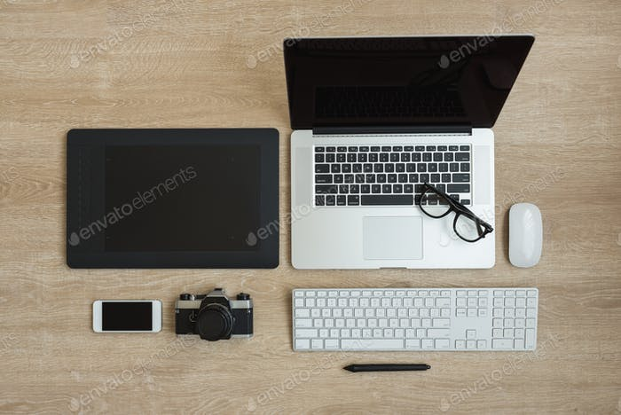 Top view of business workplace with laptop and gadgets