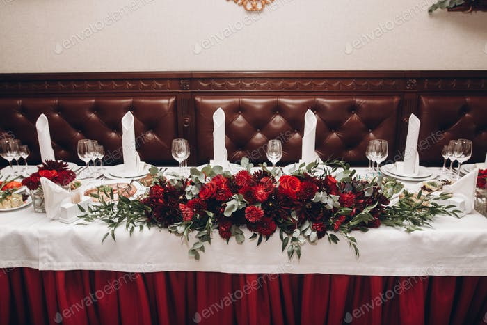 red table centerpiece with bouquet and food