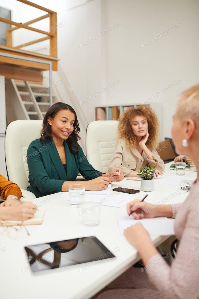 Female Office Workers Having Meeting