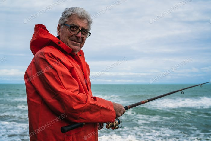 Old man fishing in the sea.