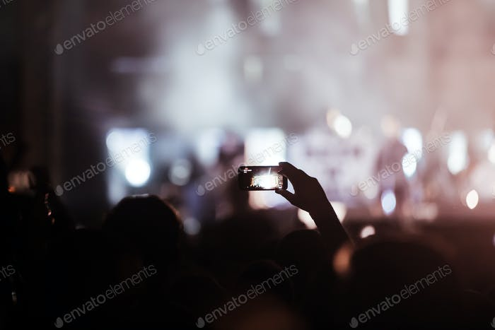Thumbnail for Cheering crowd at concert enjoying music performance