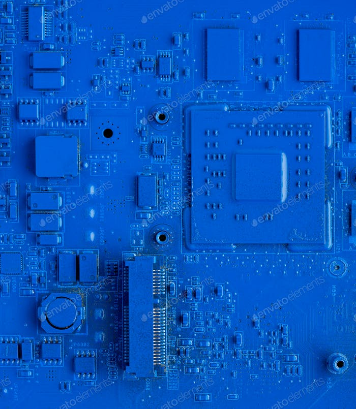 Computer motherboard. Classic blue background with pc backdrop, close up. Single color microchip
