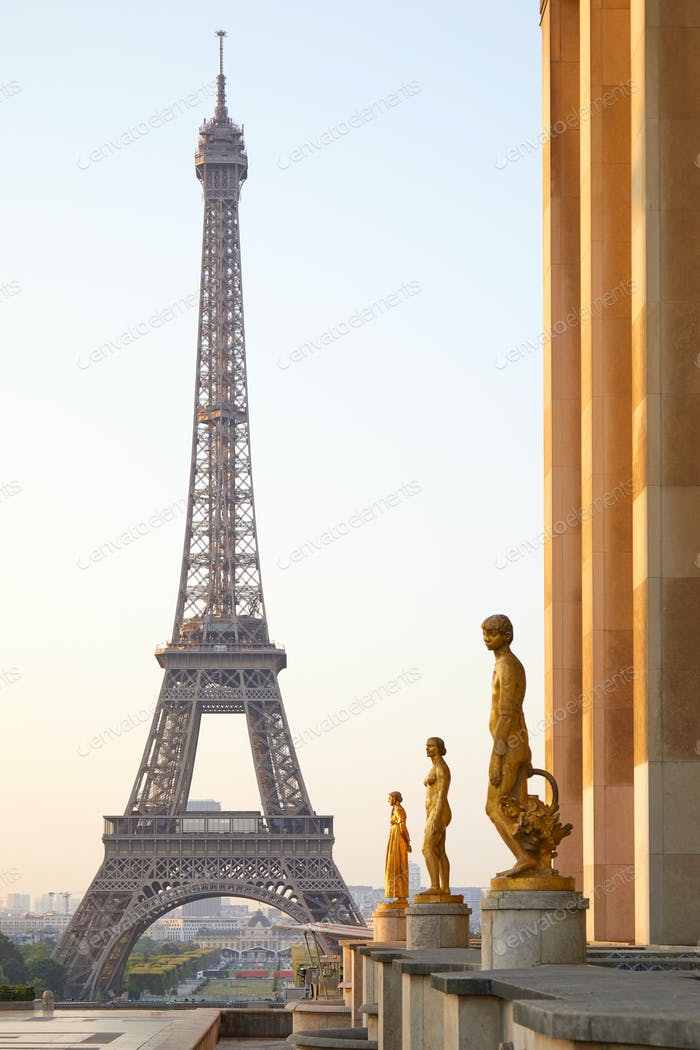 Eiffel tower and Trocadero golden statues, clear summer in Paris