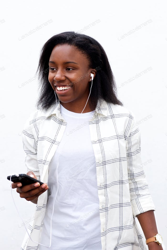Woman listening music from smartphone