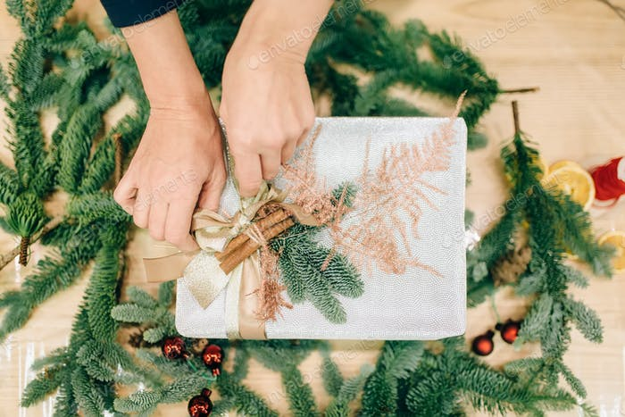 Gift box wrapping, fir tree branch decoration