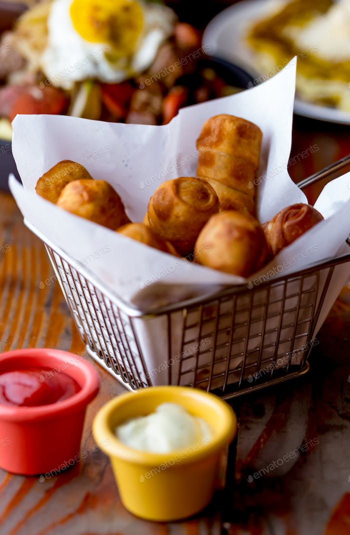 Latin American venezuelan colombian cheese Tequenos made of fried corn filled with cheese