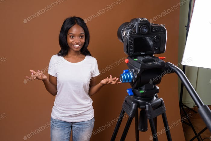Young beautiful African Zulu woman against brown background
