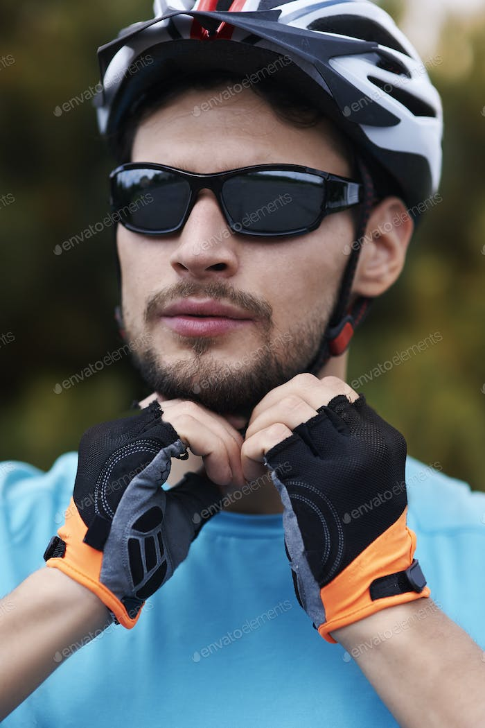 Cyclist wearing his sports helmet