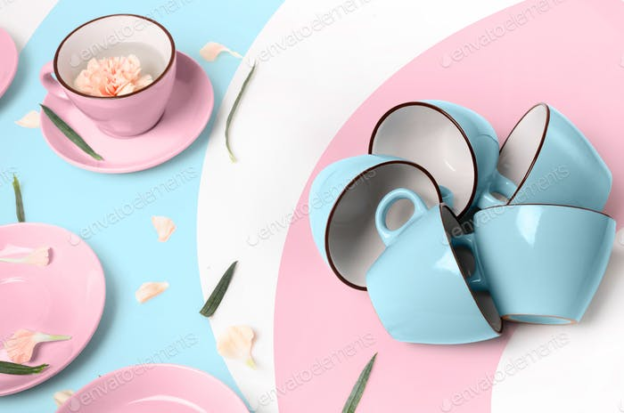 Blue and pink cups on abstract background