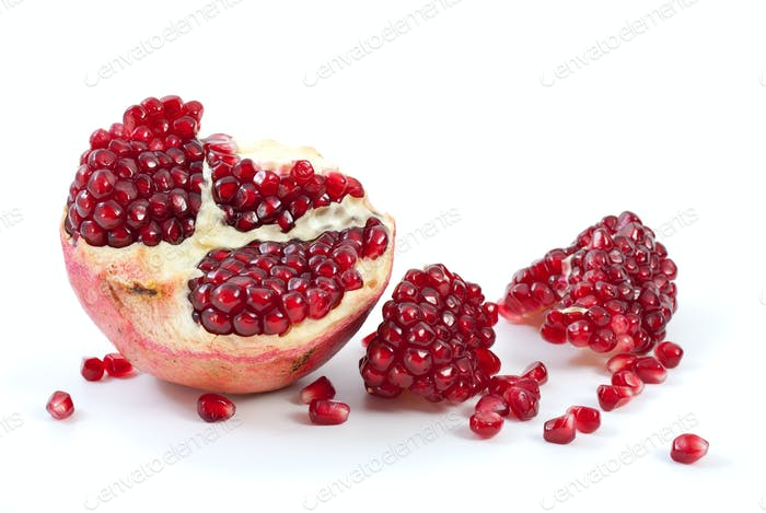 Half of pomegranate, piece and some berries