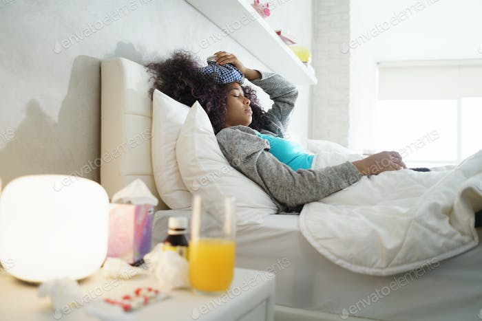 Black Woman With Flu And Cold Holding Ice Bag
