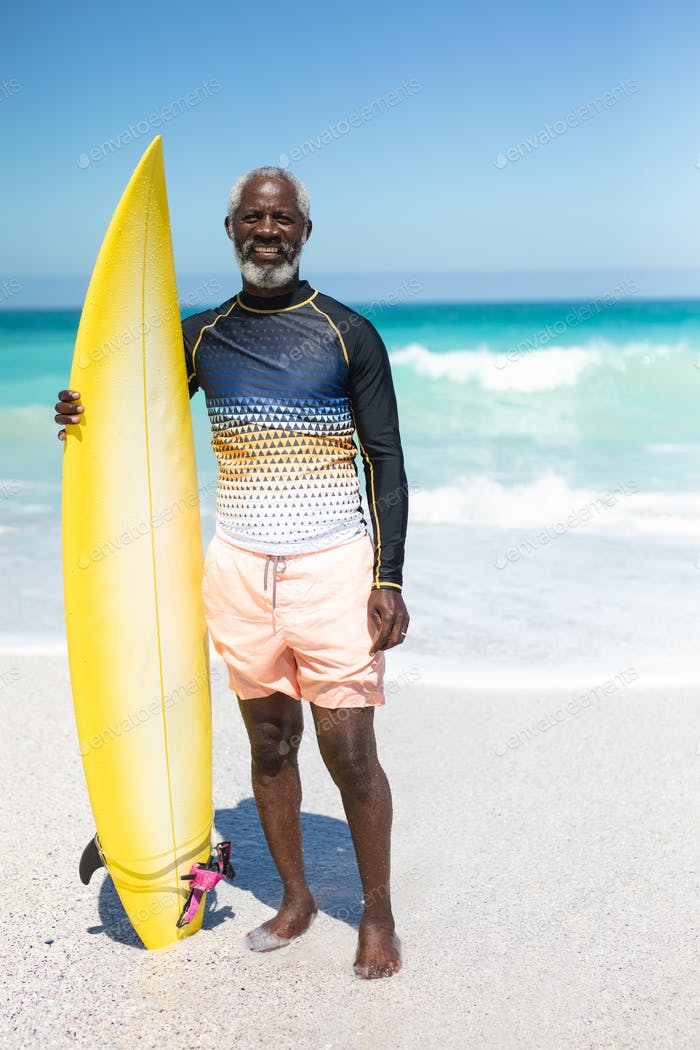 Old Man With A Surfboard At The Beach Photo By Wavebreakmedia On Envato Elements