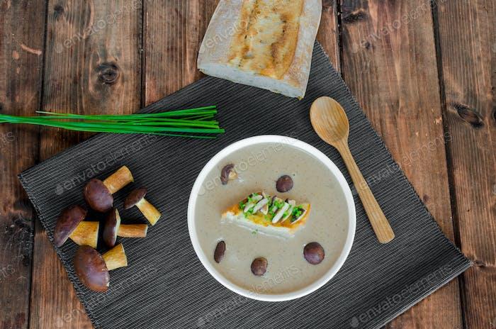 Mushroom cream soup with toast and fresh herbs