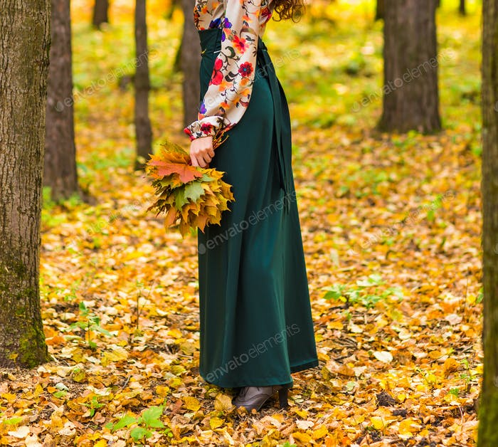 girl in autumn park with leaves