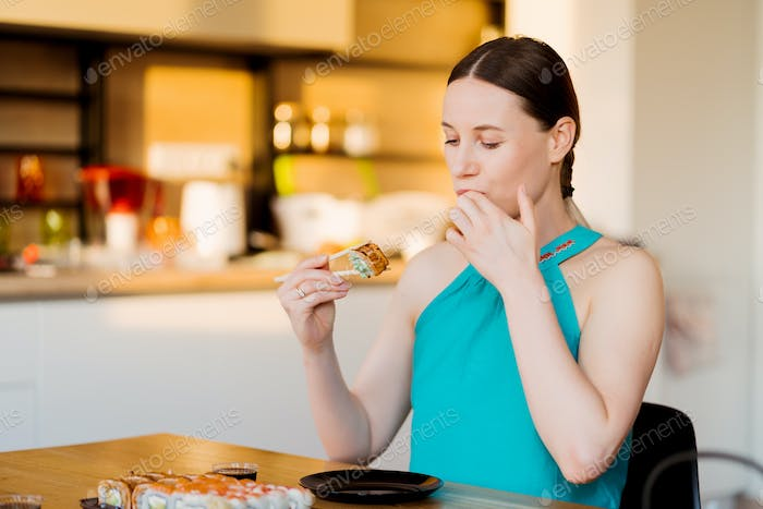 Young woman savoring her sushi