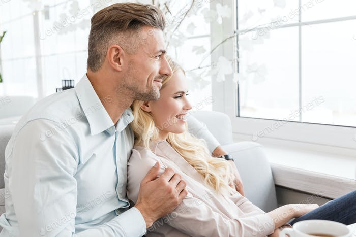 couple spending time together and looking through window