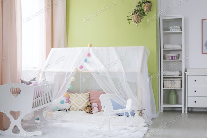 Playhouse with canopy in baby room