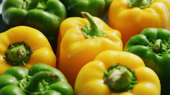 Abundance of green and yellow peppers