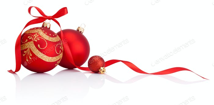 Red christmas decoration baubles with ribbon bow isolated on whi