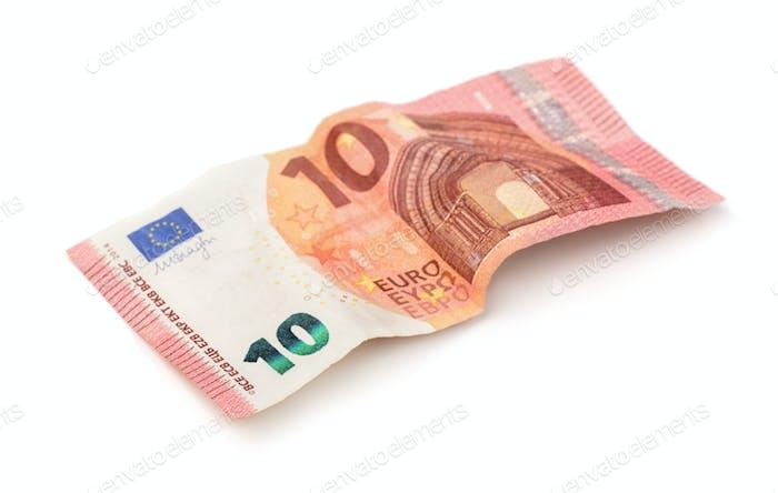 Crumpled ten euros banknote