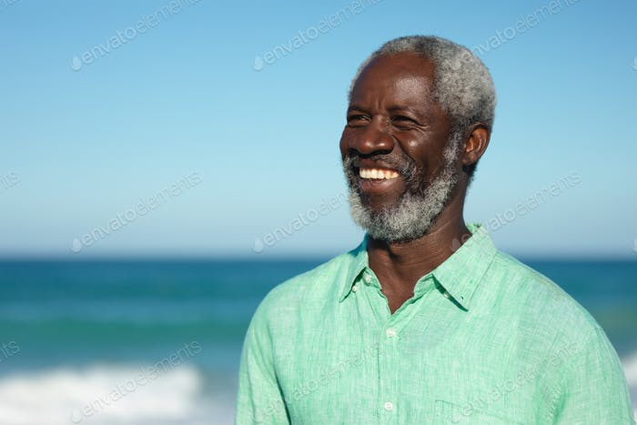 Old man smiling at the beach