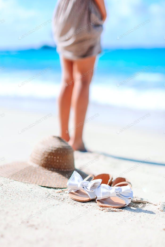 Young woman sunbathing on white beach. Legs