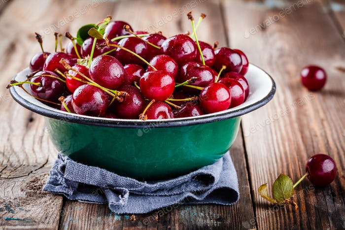 Organic ripe cherries in a bowl with drops