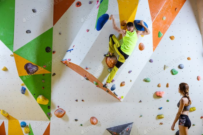 Rock climbers in climbing gym